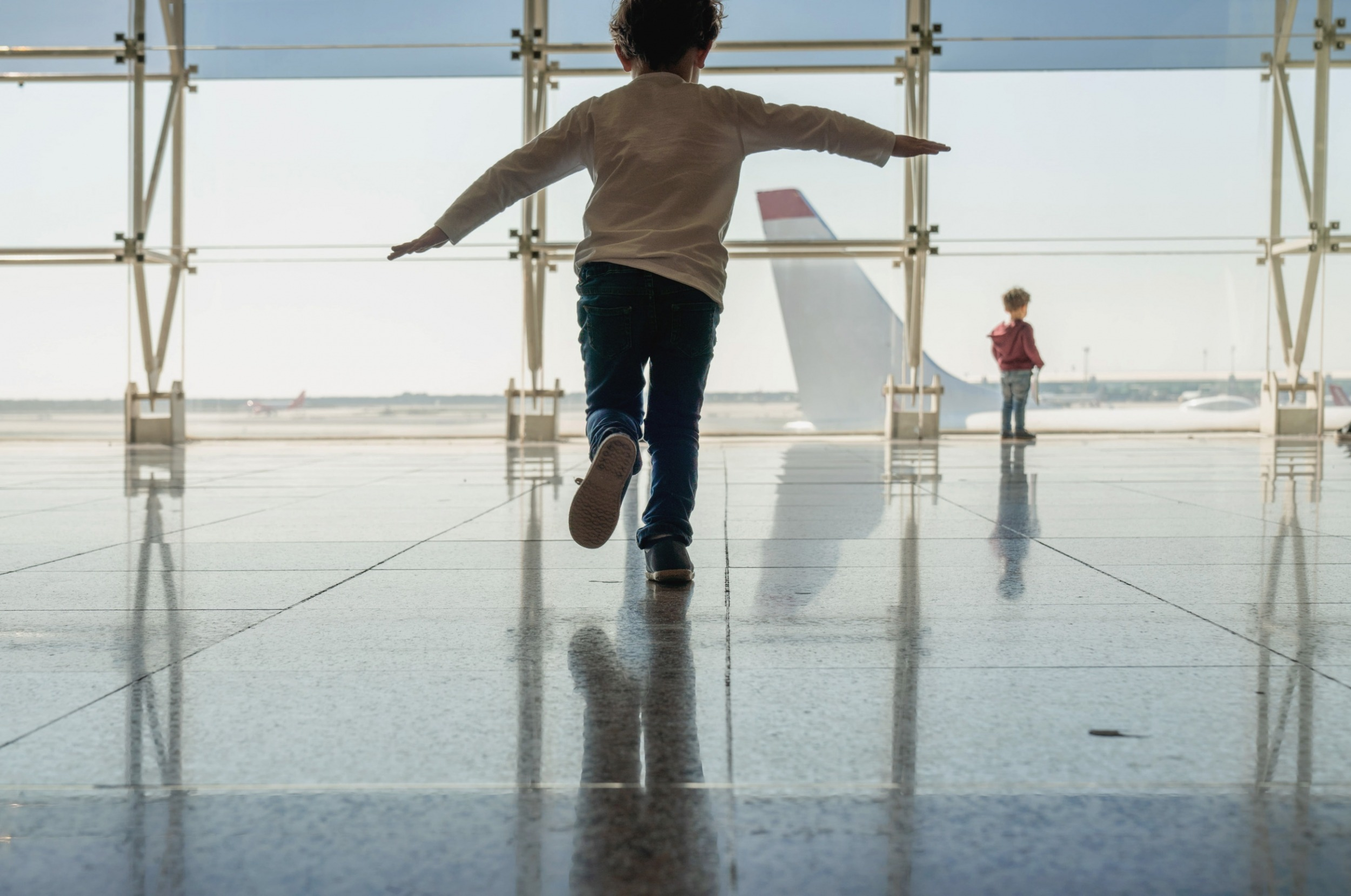 ETQ Reliance aviation safety management system child mimicking flying in airport