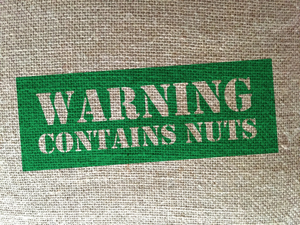 Burlap bag stamped 'Warning, contains nuts""