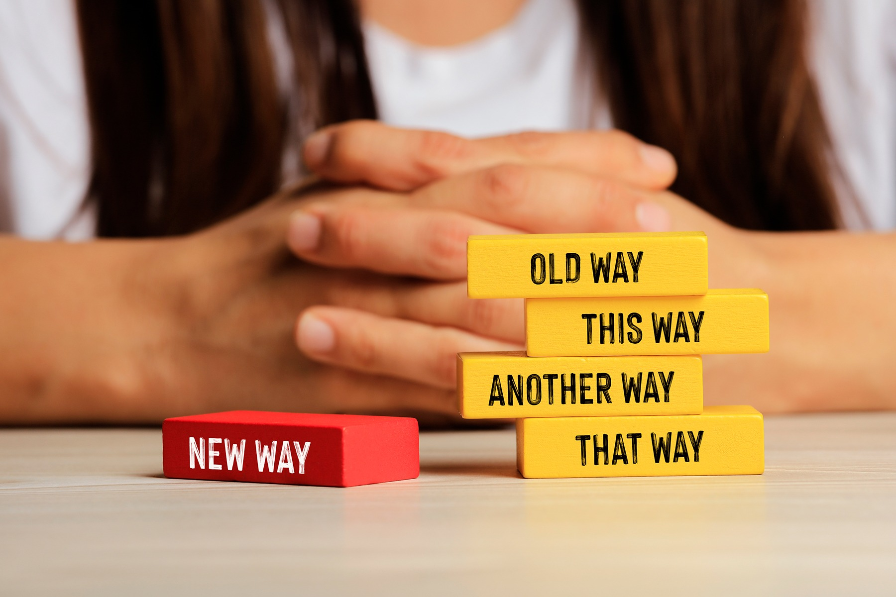 Image of blocks that say 'old way,' 'this way,' 'that way,' 'another way' and 'new way.'