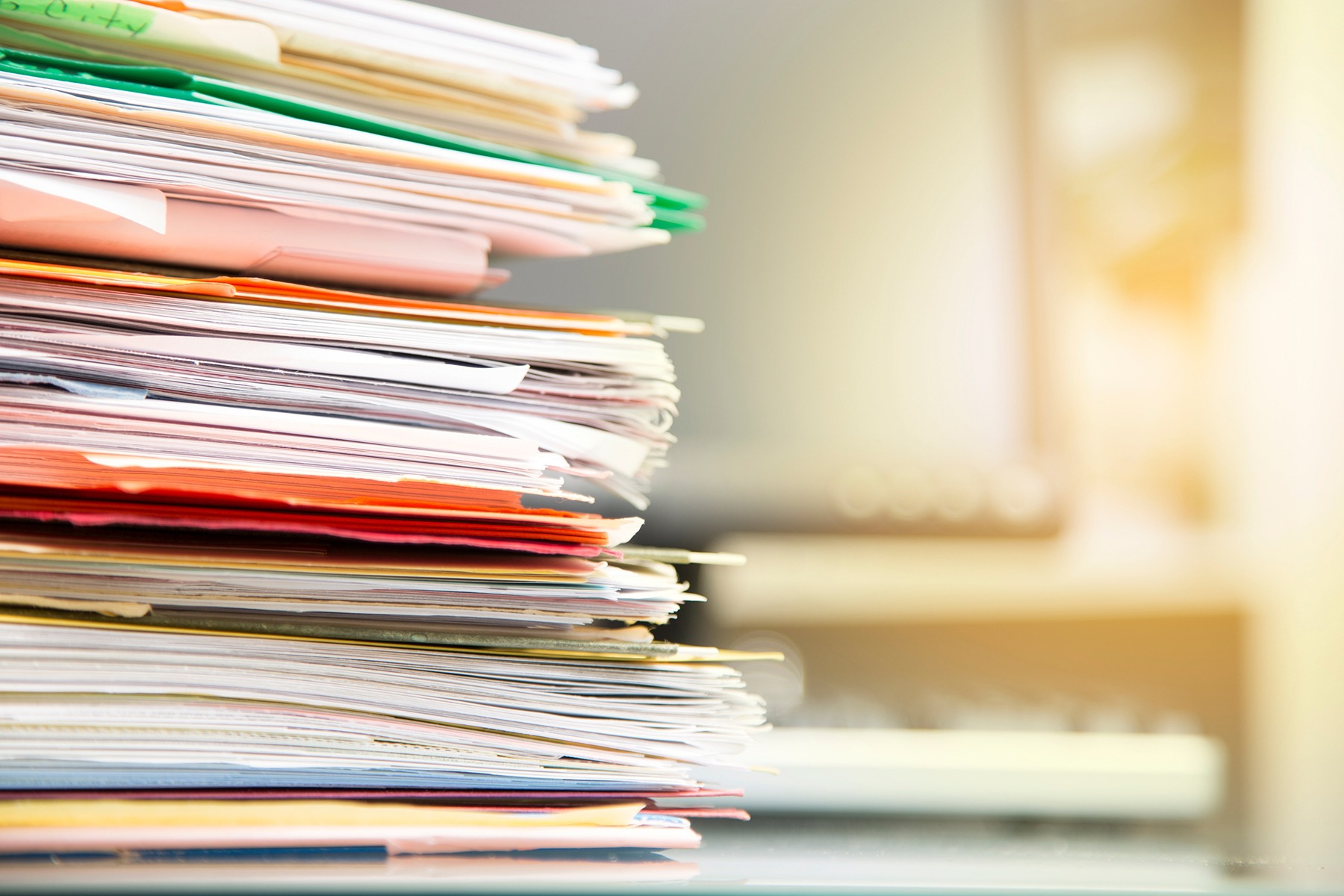 Stack of folders containing documents