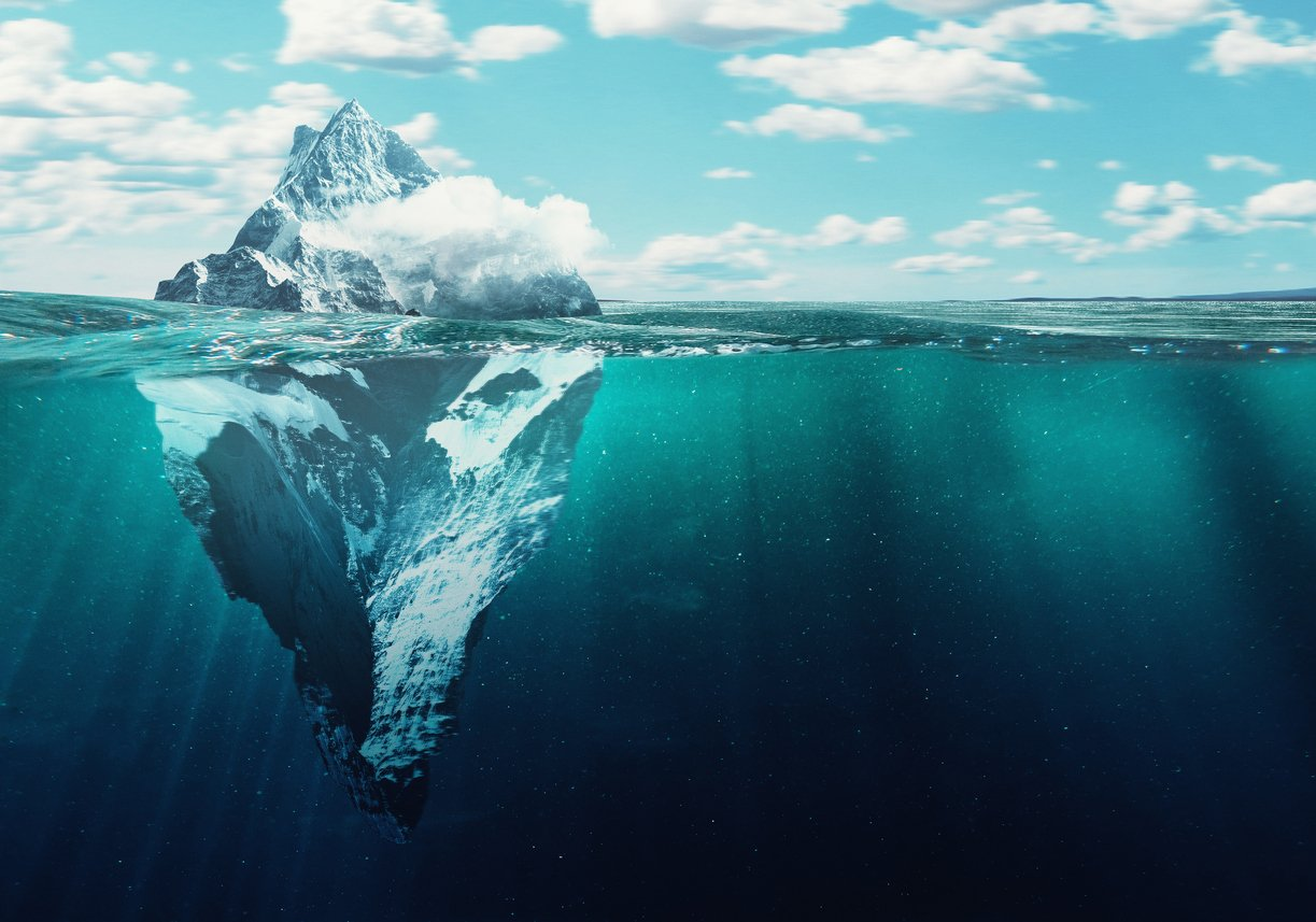 Iceberg below and above the surface of the ocean